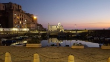 Evening shot of part of Pozzuoli port, with Rione Terra dominating on the left