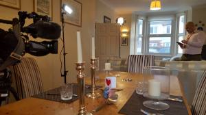 George's dining/living room with BBC crew and romantically laid-out dinner table
