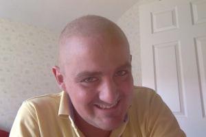 George nearly bald