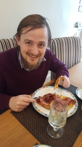 George enjoying bacon and French toast / eggy bread